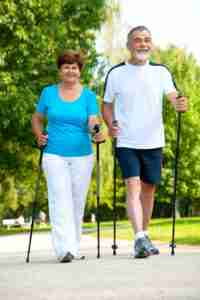 Older Couple walking with poles