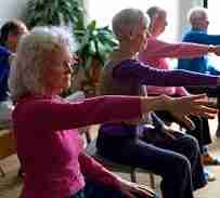 Seated group reaching an arm forward with rotation